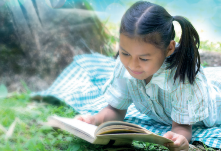 Girl reading a book - Outdoor setting