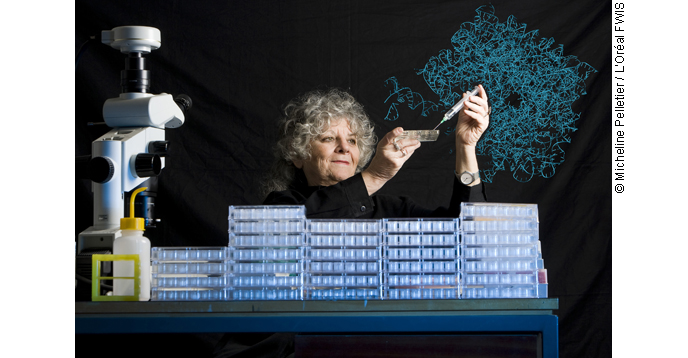 Professor Ada E. Yonath with dishes used for crystallization experiments.