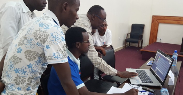 Participants following a demonstration on a software